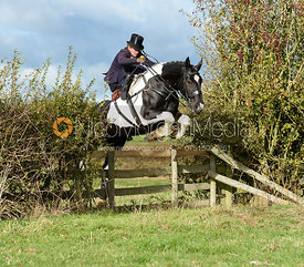 Kerry Harrison jumping a hedge near Little Dalby. Quorn Hunt Opening Meet 2018