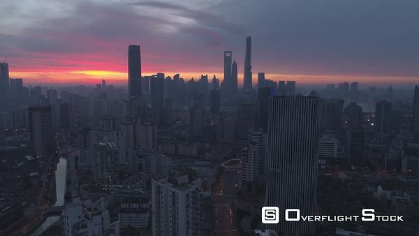 Panoramic Aerial View of Shanghai Skyline at Twilight. China. Drone is Flying Upward. Establishing Shot.
