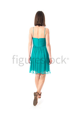 A woman in a dress walking away – shot from eye level.