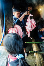Hanging Pork Meat for Smoking over Fire