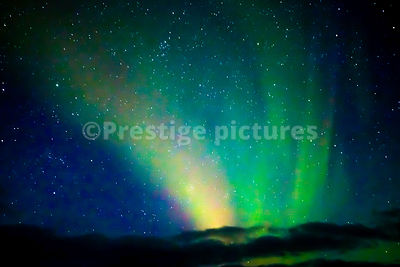 Aurora Borealis at Sea close to Svaerholt in Norway's North Cape