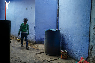 A Boy Delivers Tea Through An Alleyway