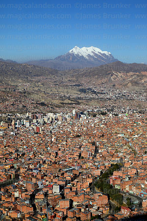 View of city and Mt Illimani, seen from Sallahumani viewpoint at La Ceja, La Paz, Bolivia