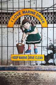 "Sign reading ""I Love Marine Drive: Keep Marine Drive Clean"" near Chowpatty Beach, Mumbai, India."