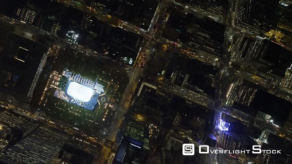 Flying southeast across Times Square and Rockefeller Center in Midtown Manhattan at night.