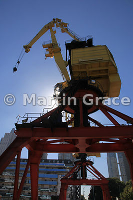 Puerto Madero docklands regeneration in Buenos Aires, Argentina, showing a restored crane against the clear blue sky