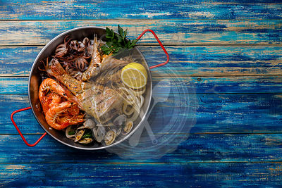 Seafood assorted platter - Prawn Shrimp, Vongole Clams, Squid rings, Octopus mini, roast Mackerel, roasted Perch copy space
