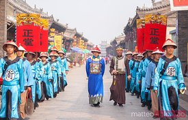 Parade of men in traditional chinese dress, Pingyao, China