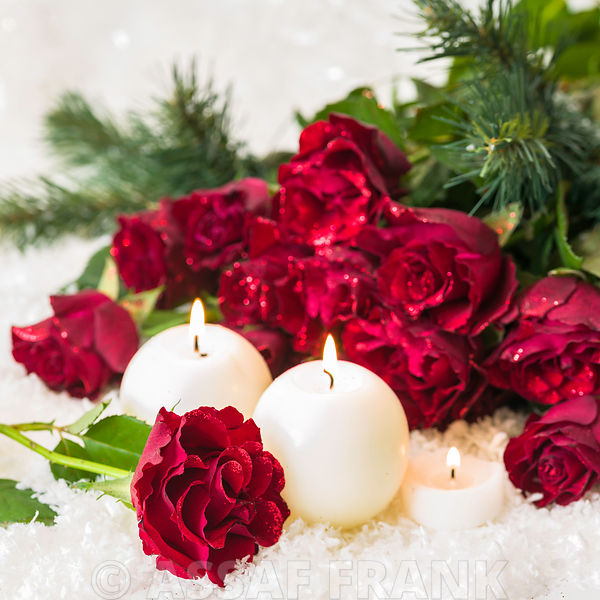 Bunch of red roses with candles