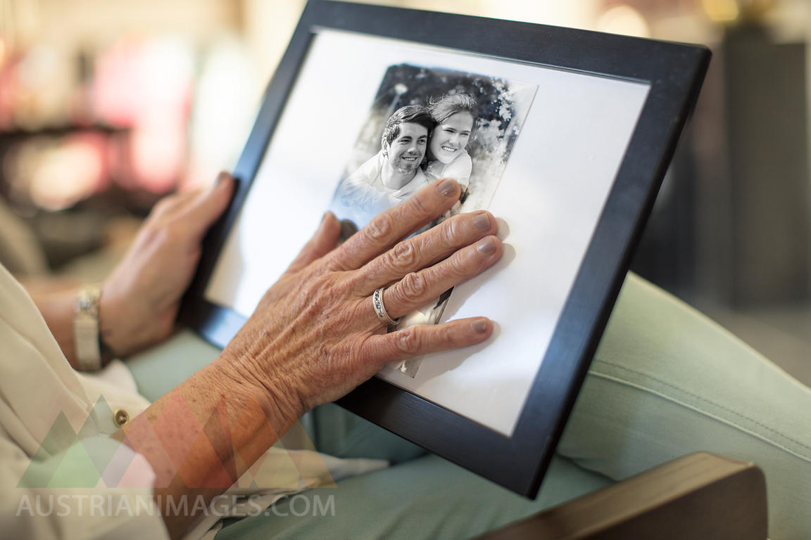 Close-up of senior woman holding a photograph