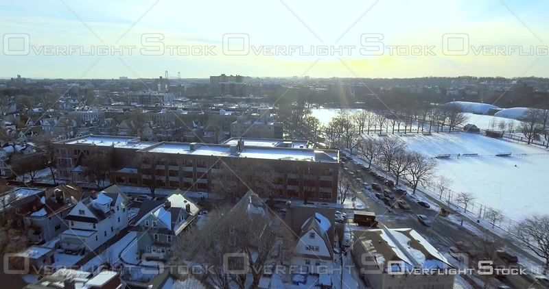 Aerial Over Snow Covered Rooftops Buildings Streets Winter Day Brooklyn Prospect Park Sunset NYC