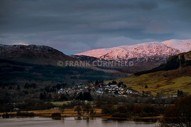 Dawn at Killin and western end of Loch Tay from Ben Lawers range in winter.