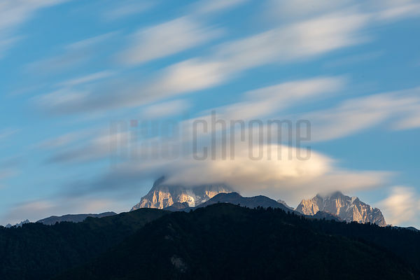 Clouds Streaking by Mount Ushba