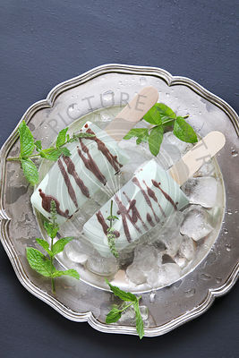 Ice cream mint popsicles drizzled with chocolate