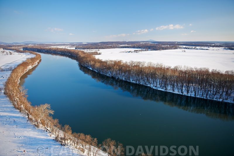 Aerial photograph of the Potomac River and fields alongside the shoreline after a mid-winter snow.