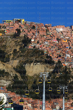 Houses on hillside and Yellow Line cable car terminal in Ciudad Satelite (El Alto), seen from La Paz, Bolivia