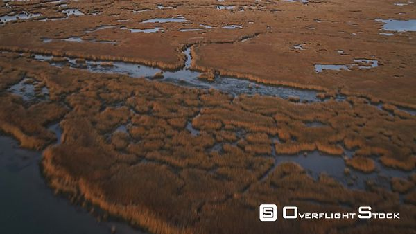 Flying over marshy barrier islands toward open sea west of Brigantine, New Jersey. Shot in November