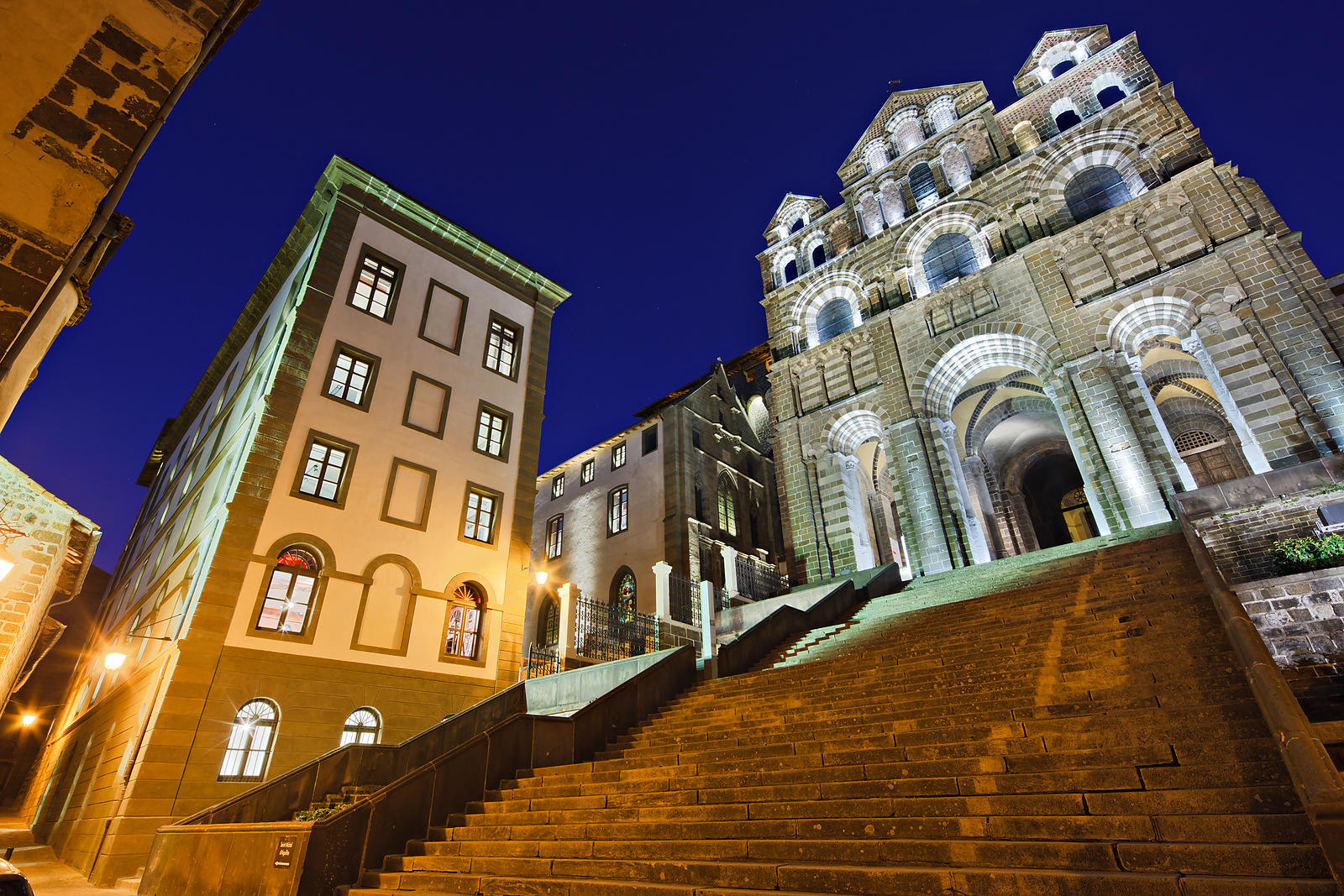Facade and stairs of Le Puy en Velay cathedral in the twilight