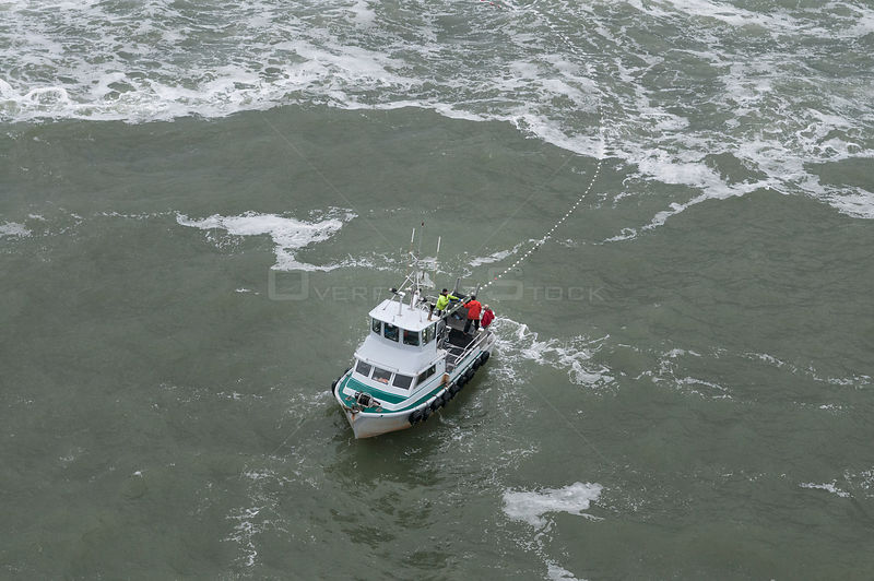 Fishing boat fishing for Sockeye salmon (Oncorhynchus nerka) using drift gill nets. Naknek River, Bristol Bay, Alaska, USA, J...