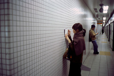 Woman writes in her diary on the Kyoto subway
