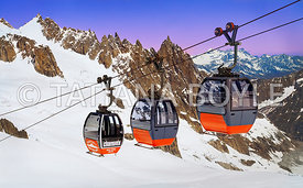 Gondolas above snowfield