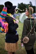 UK - Standon - A couple in fancy dress talk in a field at the Standon Calling Festival