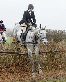 Fiona Davidson jumping a hedge near Pasture Lane
