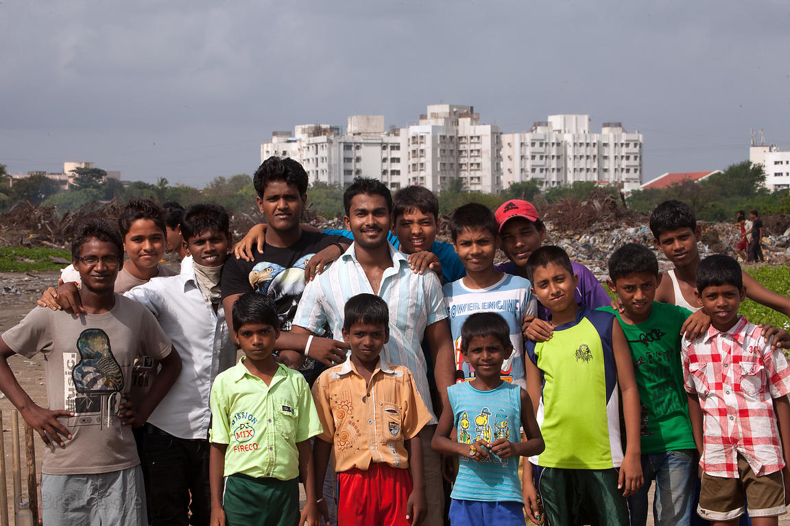 Group portrait near a slum area at the southern end of Juhu Beach, Mumbai, India.
