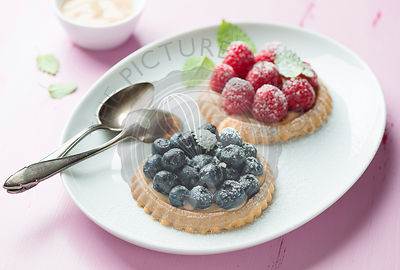 Tartlets with fresh raspberries and blueberries