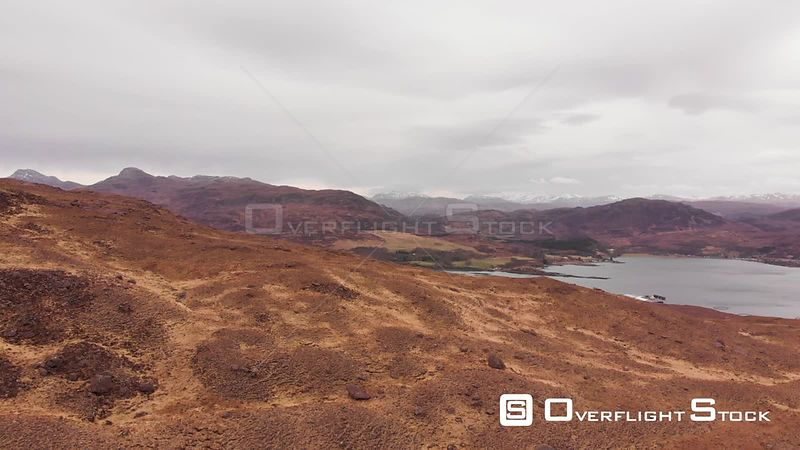 Aerial drone shot of a mountains and lochs in Highlands of Scotland