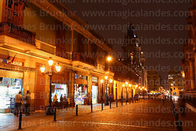 View along Jiron Carabaya towards cathedral and Plaza de Armas at night, Lima, Peru