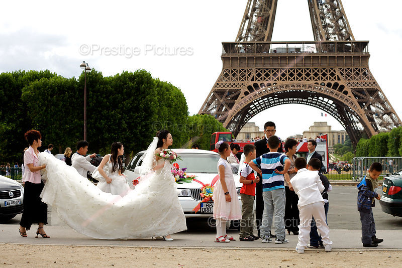 Bride and Groom Pose in front of The Eiffel Tower
