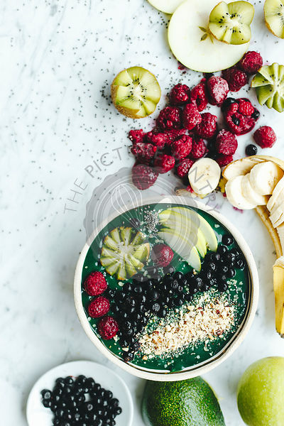 Smoothie bowl shot from the top on the marble background