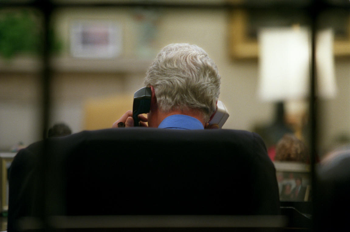President William Clinton discuses middle-east peace while on a secure phone line in the Oval Office.