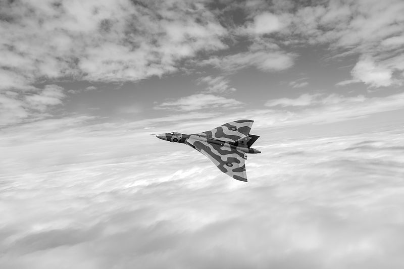 Vulcan turning above clouds BW version