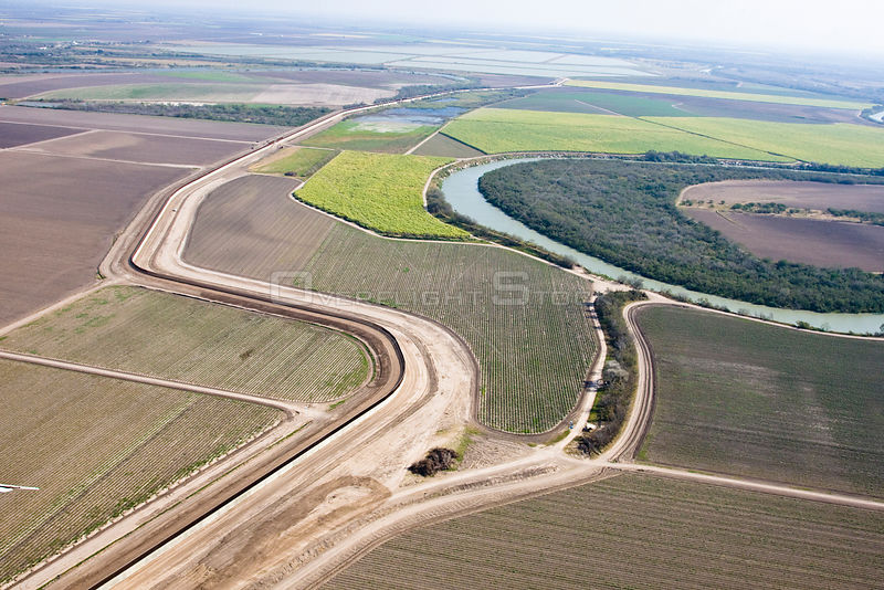 Aerial view of the US / Mexico border wall in Hidalgo County, Texas showing how wildlife corridors are severed, reduced, or e...
