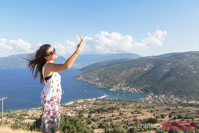 Woman doing a selfie on a lookout on the island of Kefalonia, Greek Islands, Greece