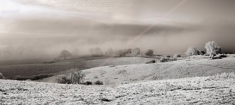 Winter storm across a frosty field in Warwickshire