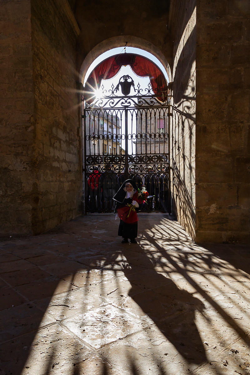 A Young Child Dressed in a Nun's Habit Waits to Enter the Duomo During the Good Friday Procession