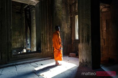 Buddhist monk inside temple, Angkor Wat, Cambodia