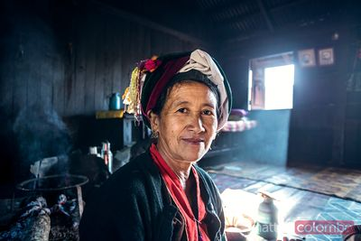 Burmese woman of shan ethnicity inside her house, Myanmar