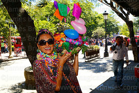 Portrait of a woman holding her decorated basket during the Comadres festival, Tarija, Bolivia