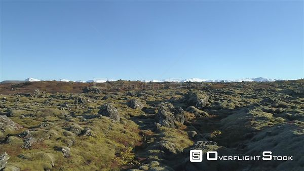 Colorful Mossy Volcanic Terrain in Autumn Iceland Drone Footage Blue Sky