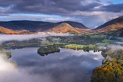 Autumn mist above Lake Grasmere in early morning, Lake District, Cumbria, England, UK. October 2012.