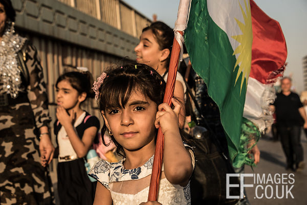 A little girl carries the Kurdish flag outside the Franso Hariri Stadium in Erbil shortly before the last rally of the Kurdis...