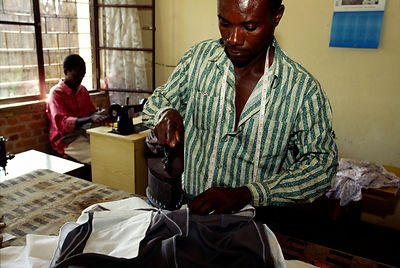 Burundi - Ruyigi - A tailor at work pressing clothes
