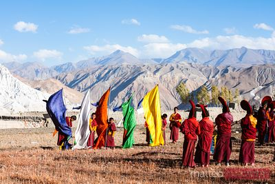 Monks with flags during a ceremony, Lo Manthang, Nepal