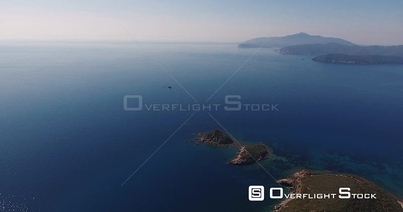 Aerial shot of a beautiful Elba island with its  gorgeous paradisiac sea in Tuscany, Italy, 4K