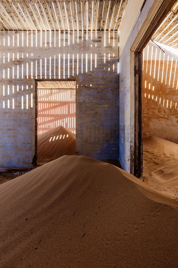Drifting Sand and Light Textures through Roof Slats