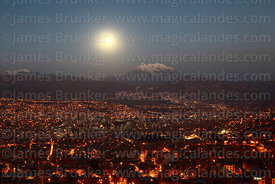 Full moon rising over La Paz and Mt Illimani, Bolivia